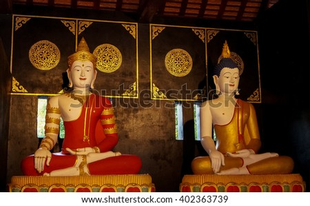 Two buddhas at Wat Chedi Luang Complex - The Wat Chedi Luang Complex at Chiang Mai is surrounded by many Buddha statues pointing out aspects of the buddhist history - stock photo