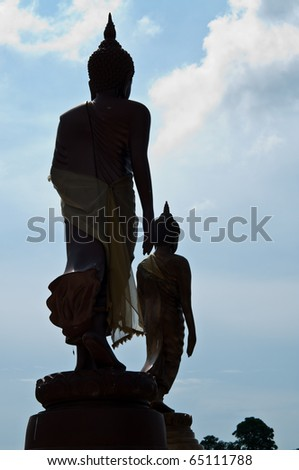 Two buddhas walking statue, Thailand. - stock photo