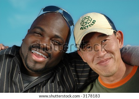 Two buddies hugging and just having fun - stock photo