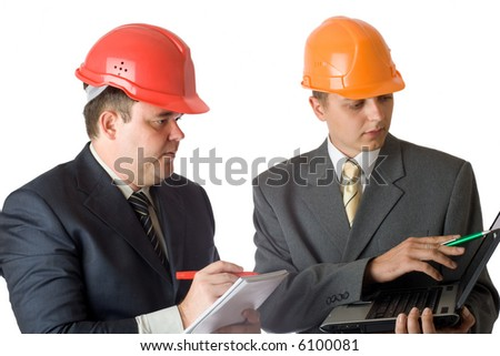 Two builders with laptop - stock photo