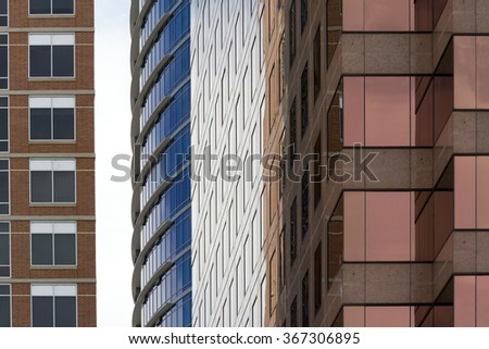 two buildings very close together - stock photo
