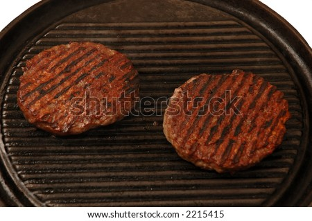 two burgers cooking - stock photo