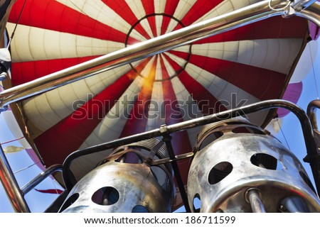 two burner-jets of hot air balloon, unusual upwards view - stock photo