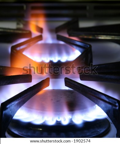 Two burners on a natural gas kitchen stove.