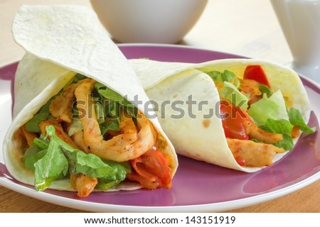 Two burritos on a plate - stock photo