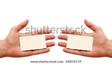 two business cards in hands - stock photo