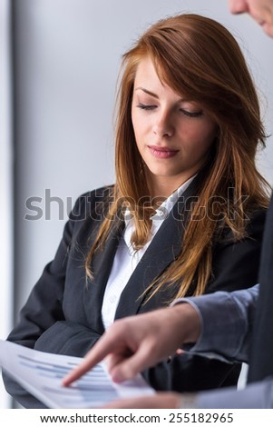 Two business colleagues analyzing data in an office - stock photo