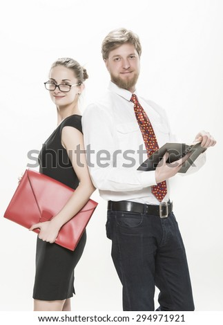 Two business colleagues, businessman standing with his female colleague smiling and looking to you, teamwork concept - stock photo
