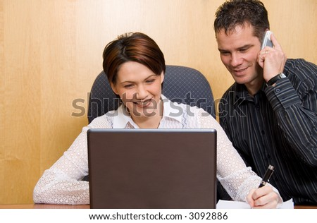 two business colleagues in a boardroom in a meeting