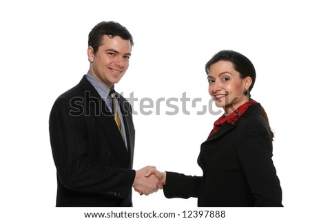 Two business colleagues smiling and shaking hands. Isolated against a white background