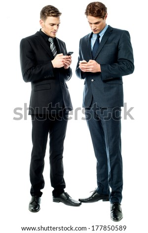 Two business executives sharing their contacts - stock photo