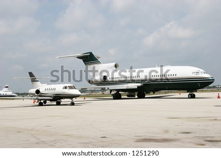 two business jets next to each other