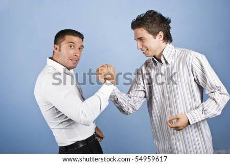 Two business man confrontation  or fight in business isolated on blue background