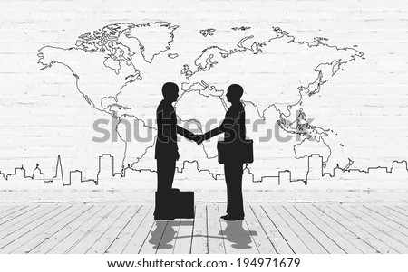Two business man shake hand silhouettes city with world maps stroke - stock photo