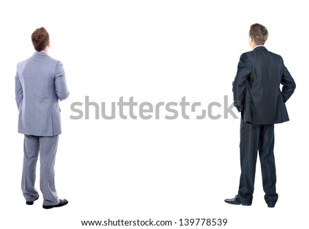 two business mans from the back - looking at something over a white background - stock photo