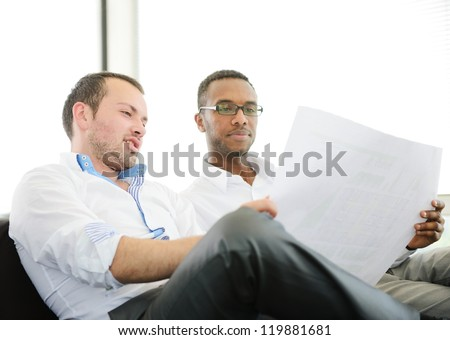 Two business men at work discussing a project - stock photo