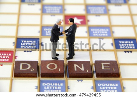 Two business men closing a deal.