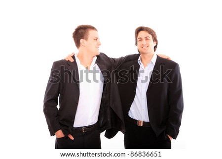 Two business men discuss. Isolated over white background.