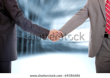 two business men handshake in office - Agreed on the deal - stock photo