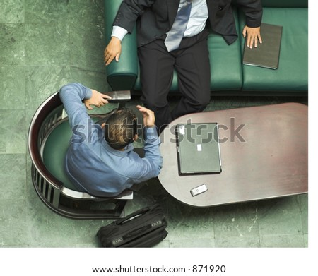 Two business men in a meeting. - stock photo