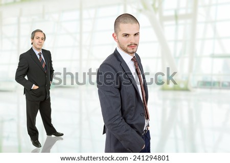 two business men portrait at the office - stock photo