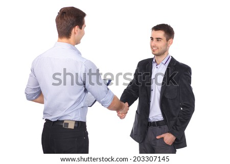 Two business men shaking hands and one of them holding a folder with contract - stock photo