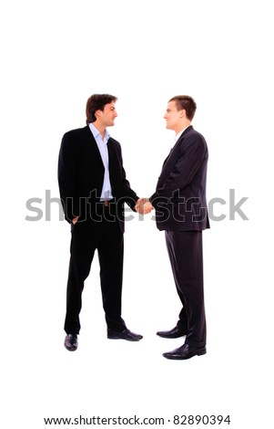 two business men shaking hands, isolated on white - stock photo