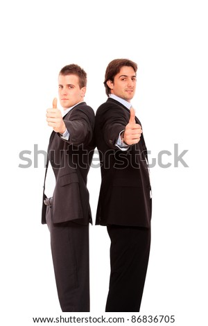 Two business men standing back to back thumb up  isolated - stock photo
