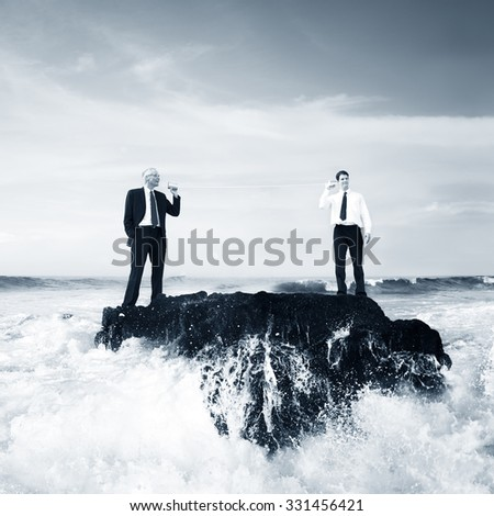 Two Business Men Talking Tin Phone Ocean Concept - stock photo