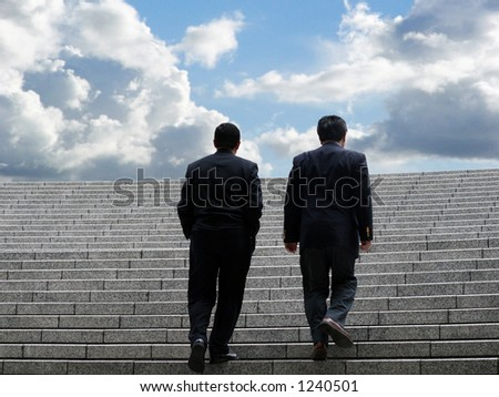 Two business men walking up the stairs - stock photo