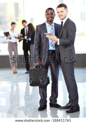 Two business men working together in the office  - stock photo
