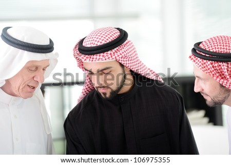 Two business men working together on project