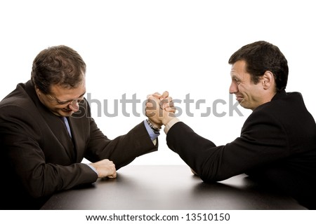 two business men wrestling isolated on white background