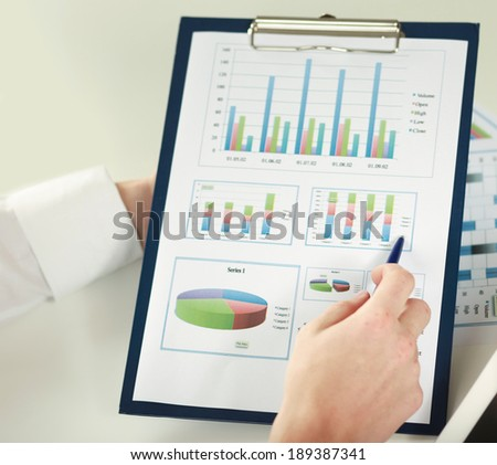 two business partners discussing documents - stock photo