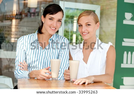 Two business partners having coffee - stock photo