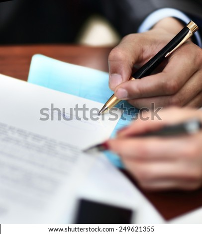 Two business partners signing a document - stock photo