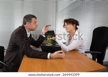 Two business people conversing and negotiating - stock photo