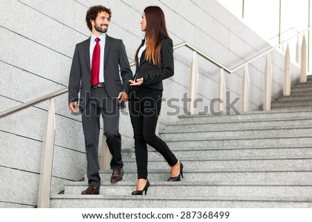 Two business people discussing outdoor
