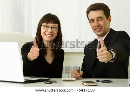 Two business people doing the ok sign in office - stock photo