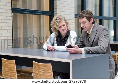 Two business people  having a business meeting - stock photo