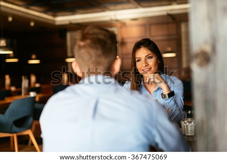 Two business people having an informal meeting in a cafe. - stock photo
