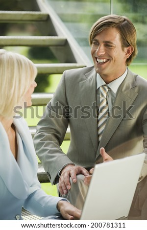 Two business people having conversation
