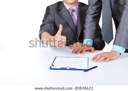 Two business people in elegant suits sitting at desk working in team  sign up contract, plan, holding hand with thumbs up gesture. Concept Success, Approval, Good Work, Isolated over white background