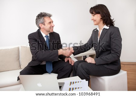 Two business people in the office at the meeting