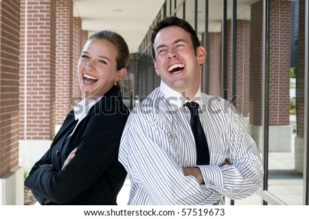 Two business people laughing