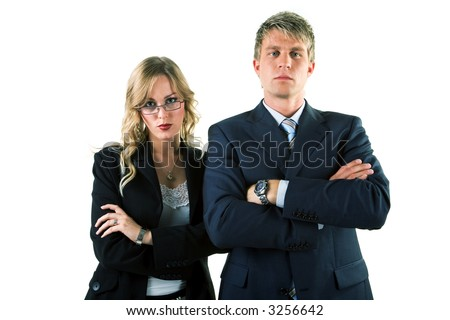 Two business people (male / female) with folded arms blocking the way - stock photo
