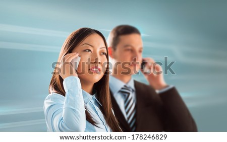 Two business people man and woman standing together and talking by phone on technological background