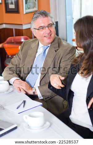 Two business people meeting - stock photo