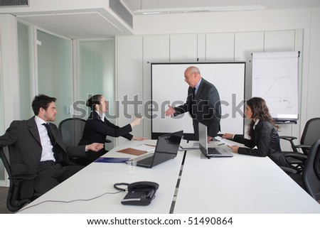Two business people quarreling during a meeting with two other business people - stock photo