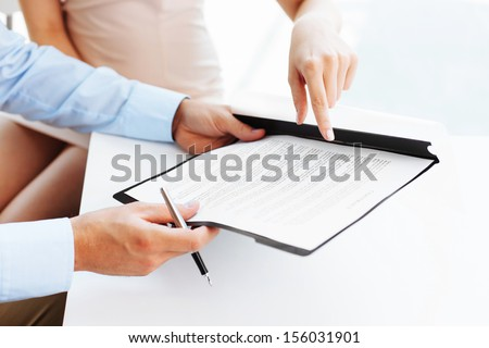 Two business people signing a contract - stock photo